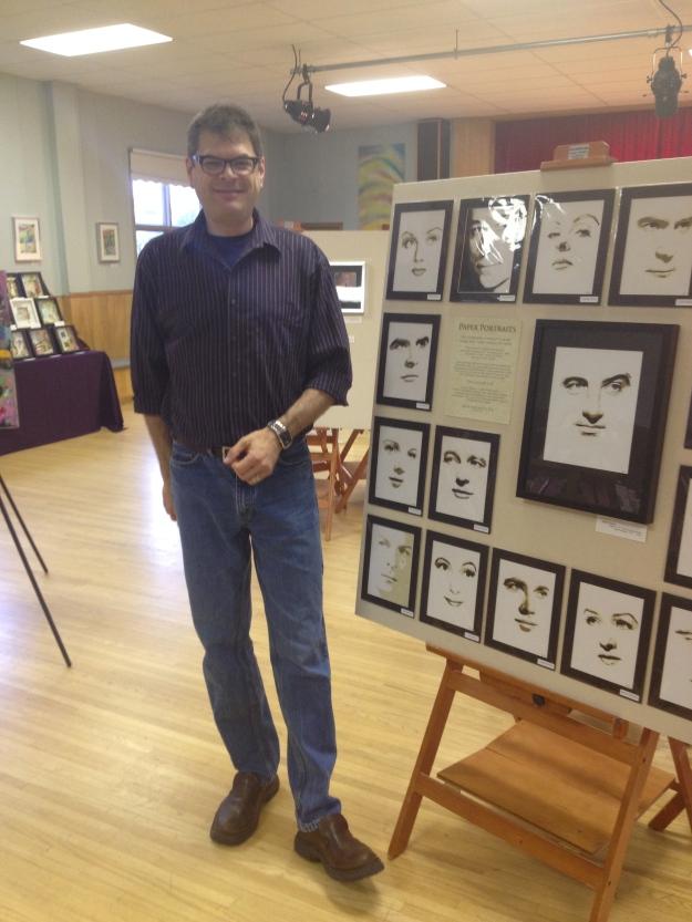 Eden Thompson with his paper cut portraits.