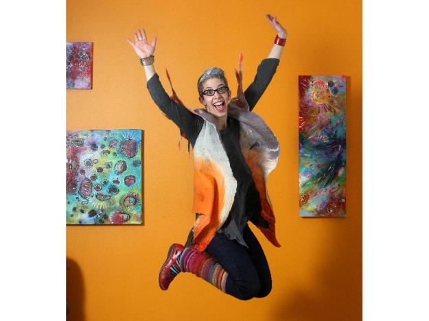 Artist Belinda Fireman shows her style in the basement studio of her  Calgary home . She is wearing a vest by local artist Viva Felt, a red leather cuff by Fehu, a shirt by Nally and Millie, Gap jeans, homemade knit leg warmers and Naot shoes.